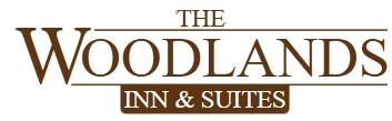 Image of Woodlands Inn & Suites's Logo